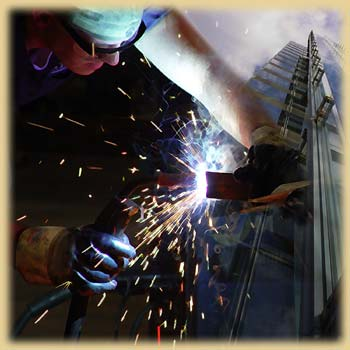 A man uses a welding iron.